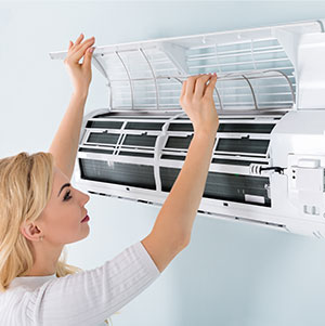 Woman looking in her A/C Unit